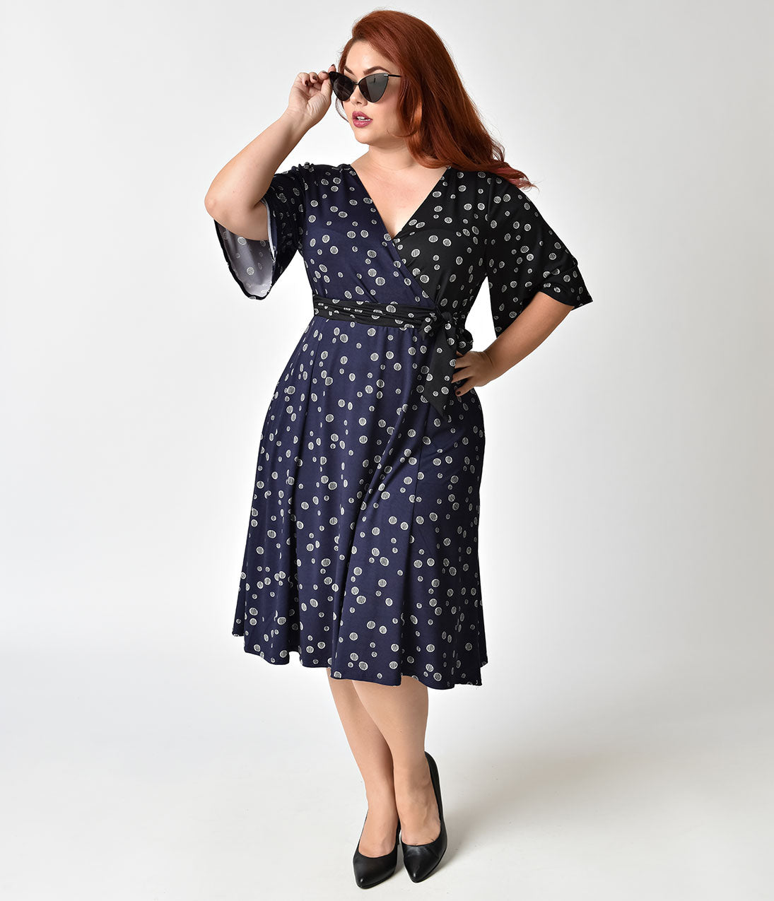 Polka Dot Dresses: 20s, 30s, 40s, 50s, 60s Plus Size Navy  Black Dot Mix Sleeved Aria Tie Wrap Dress $78.00 AT vintagedancer.com