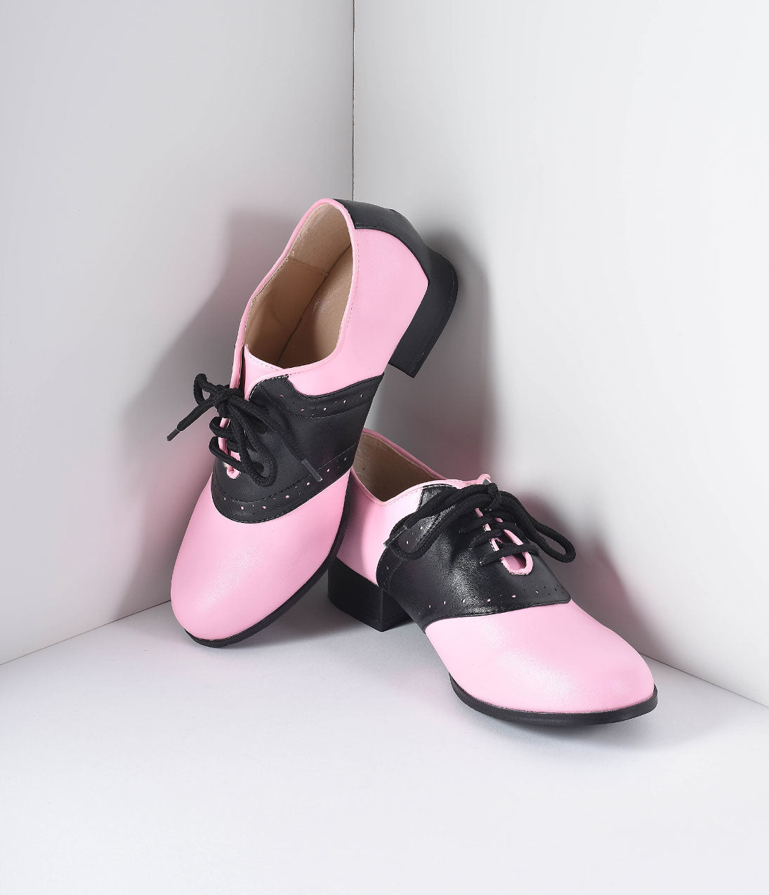 1950s Shoe Styles: Heels, Flats, Sandals, Saddles Shoes Retro Style Pink  Black Two Tone Saddle Shoes $42.00 AT vintagedancer.com