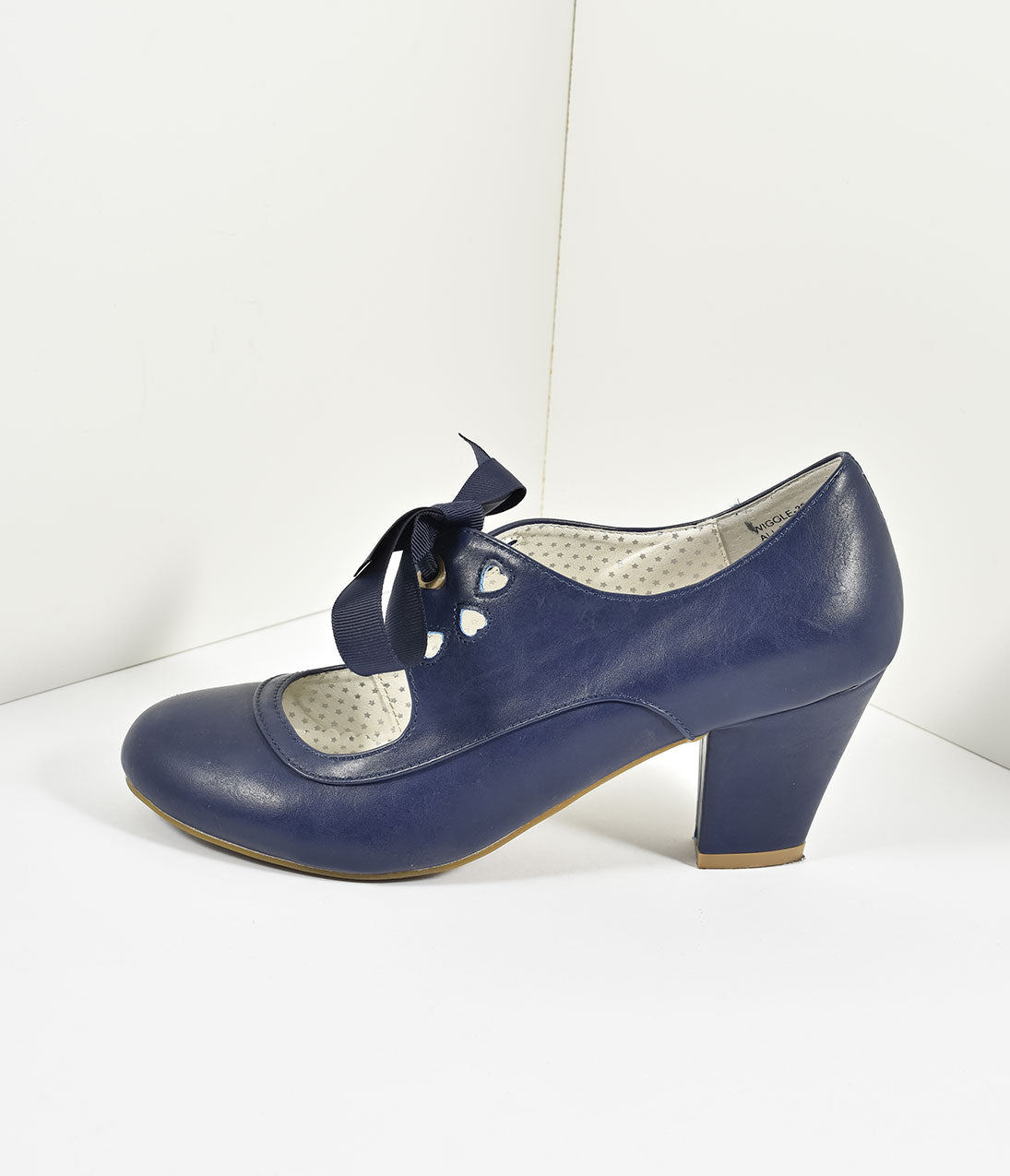 10 Popular 1940s Shoes Styles for Women Vintage Style Navy Blue Leatherette Mary Jane Bow Wiggle Heels $58.00 AT vintagedancer.com