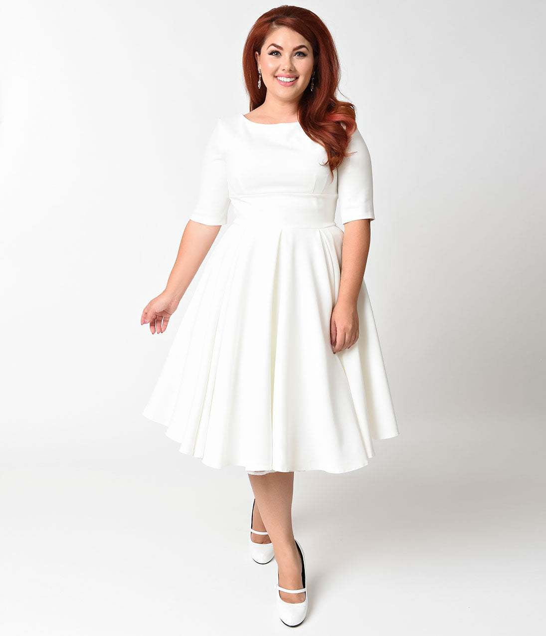 60s Wedding Dresses | 70s Wedding Dresses The Pretty Dress Company Plus Size Ivory Crepe Sleeved Hepburn Swing Dress $172.00 AT vintagedancer.com