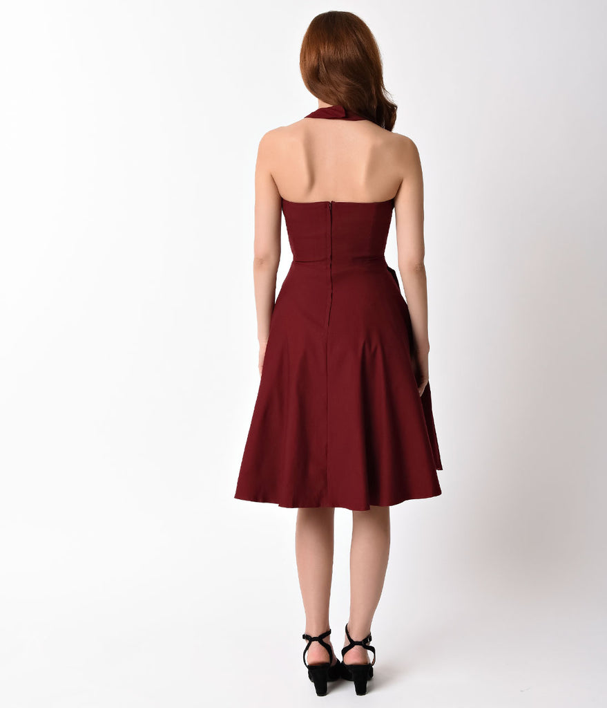 Unique Vintage 1950s Burgundy Red Cross Halter Rita Flare Dress