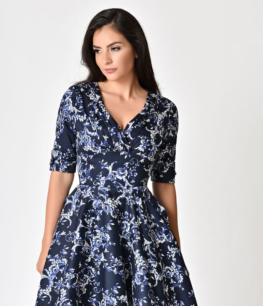 Unique Vintage 1950s Navy Blue Floral Delores Swing Dress with Sleeves