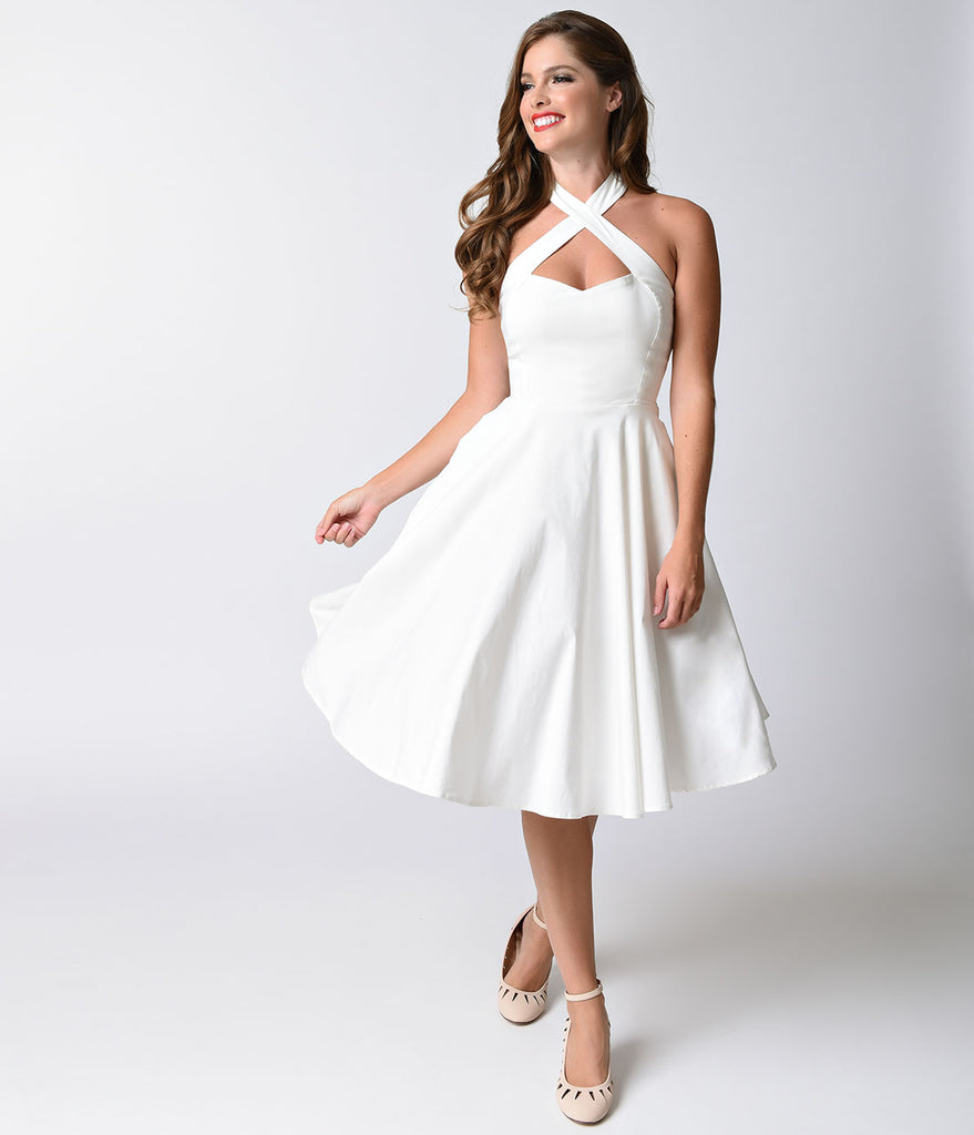 Unique Vintage 1950s Style Ivory Criss Cross Halter Flare Rita Dress