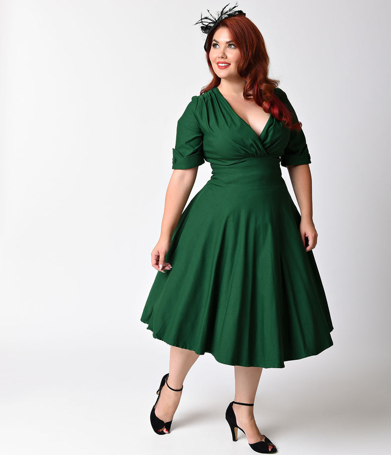 Unique Vintage Plus Size 1950s Emerald Green Delores Swing Dress with Sleeves