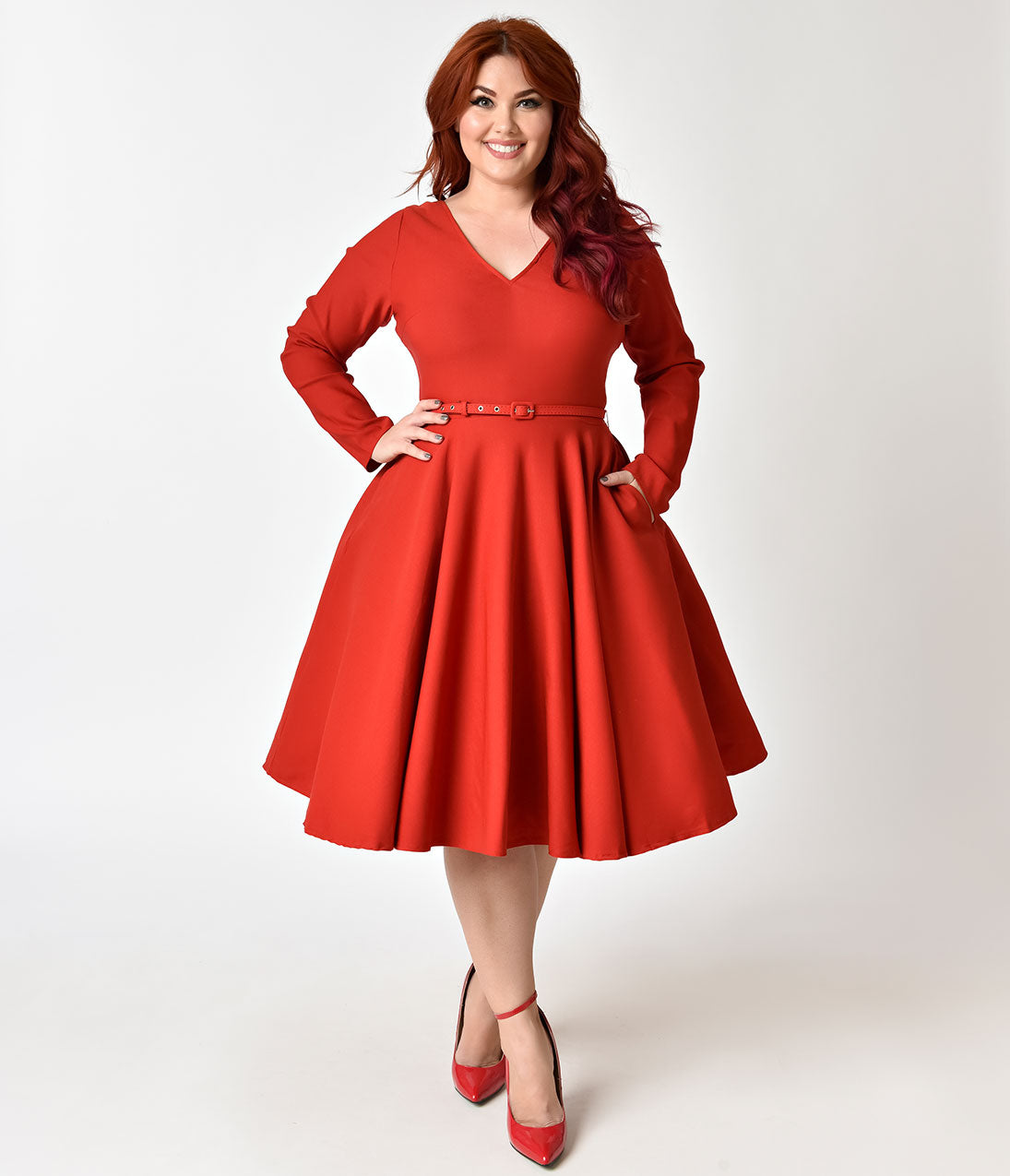 1950s Plus Size Fashion & Clothing History 1950s Style Red Stretch Long Sleeve Maude Swing Dress $74.00 AT vintagedancer.com