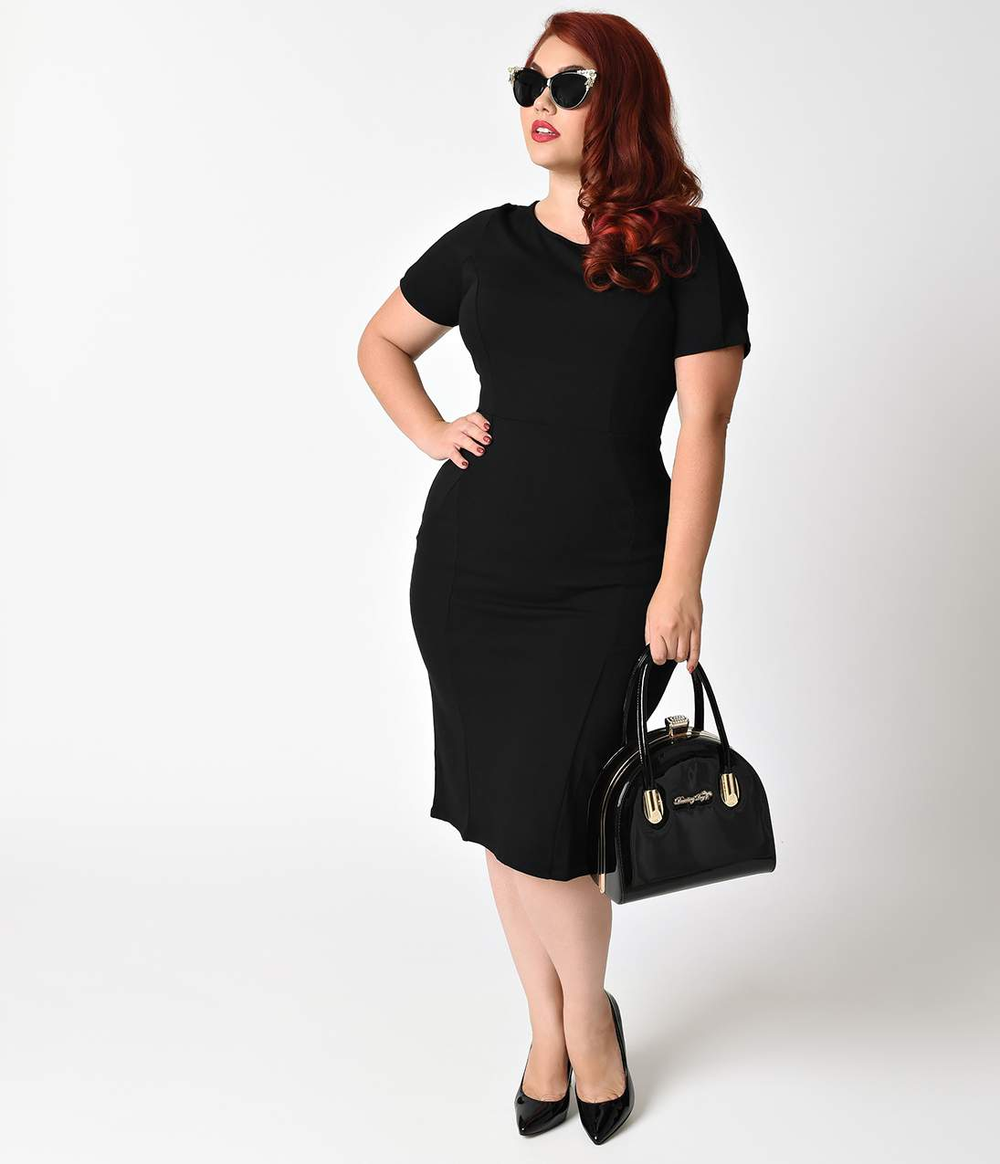 Plus Size Vintage Dresses, Plus Size Retro Dresses Unique Vintage Plus Size 1960S Style Black Short Sleeve Stretch Mod Wiggle Dress $48.00 AT vintagedancer.com