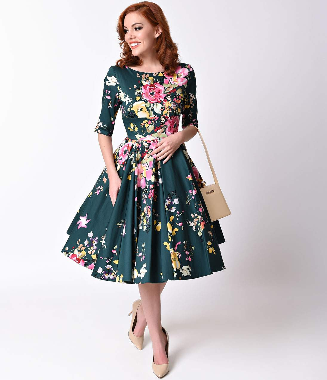 1950s Dresses, 50s Dresses | 1950s Style Dresses Vintage Deep Green Seville Floral Half Sleeve Hepburn Swing Dress $188.00 AT vintagedancer.com