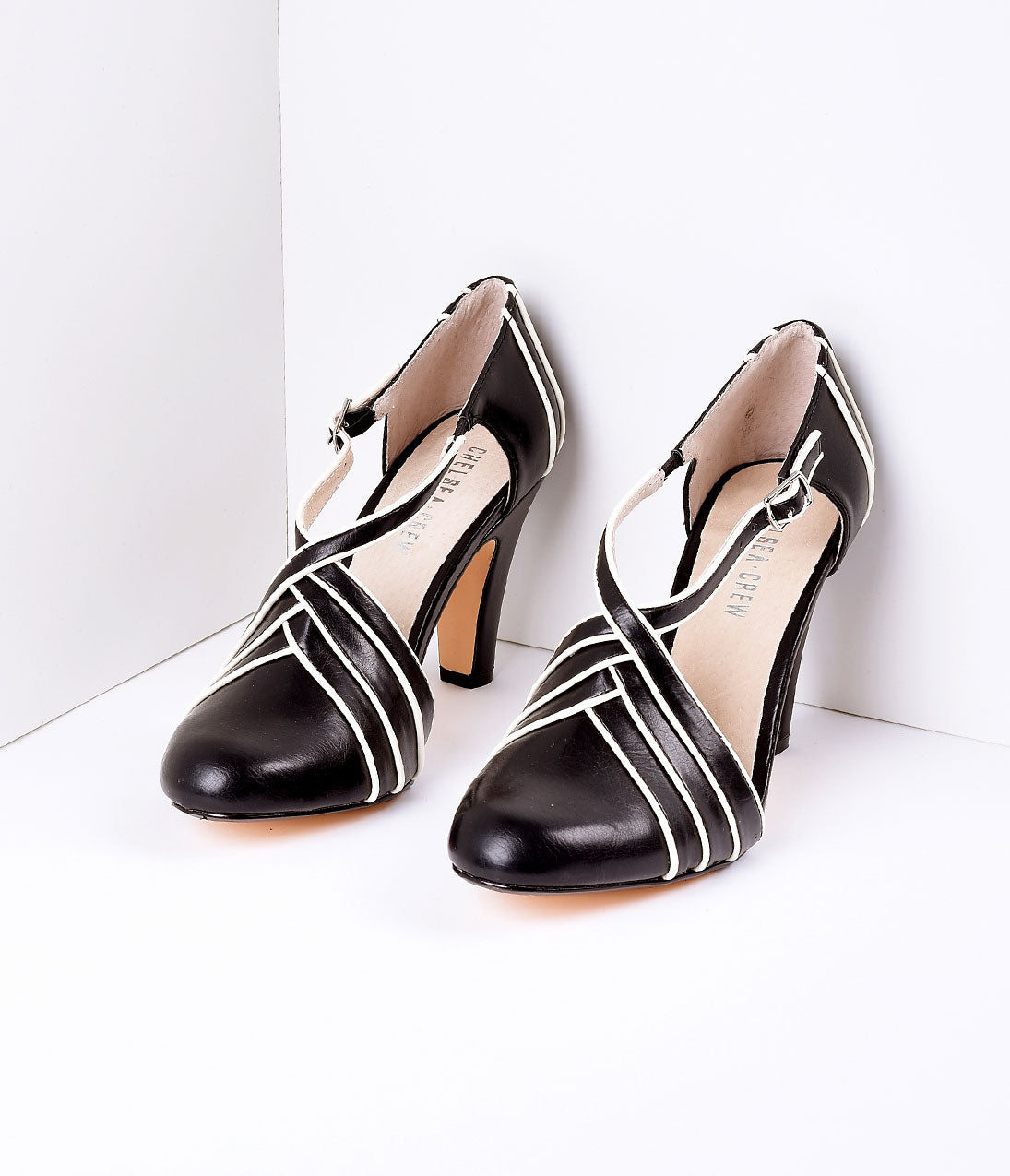 1950s Style Shoes | Heels, Flats, Saddle Shoes Vintage Style Black  Ivory Wrapover Leatherette DOrsay Heels $64.00 AT vintagedancer.com