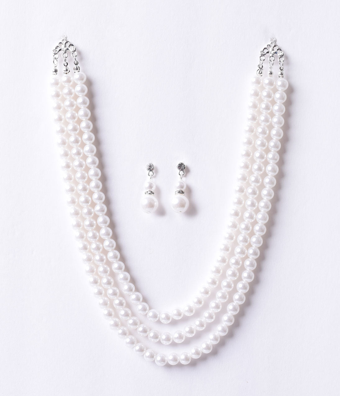 50s Jewelry: Earrings, Necklace, Brooch, Bracelet Vintage Style Ivory Triple Pearl Beaded Necklace  Earring Set $34.00 AT vintagedancer.com
