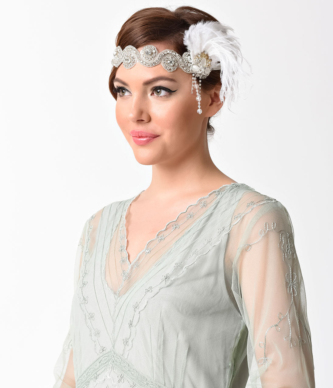 1920s Accessories: Feather Boas, Cigarette Holders, Flasks Vintage Style Silver Rhinestone Swirl  White Feather Headband $32.00 AT vintagedancer.com