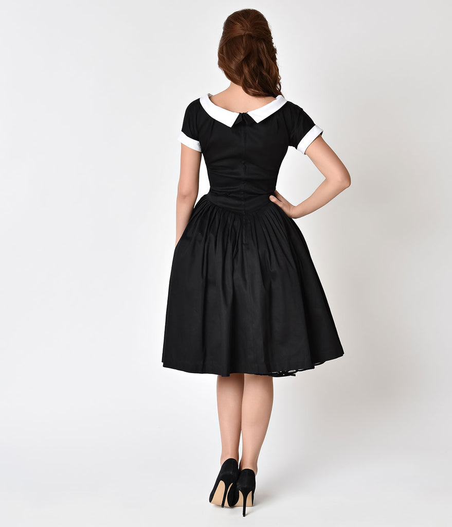 Unique Vintage 1950s Style Black Cap Sleeve Pleated Waldorf Swing Dress
