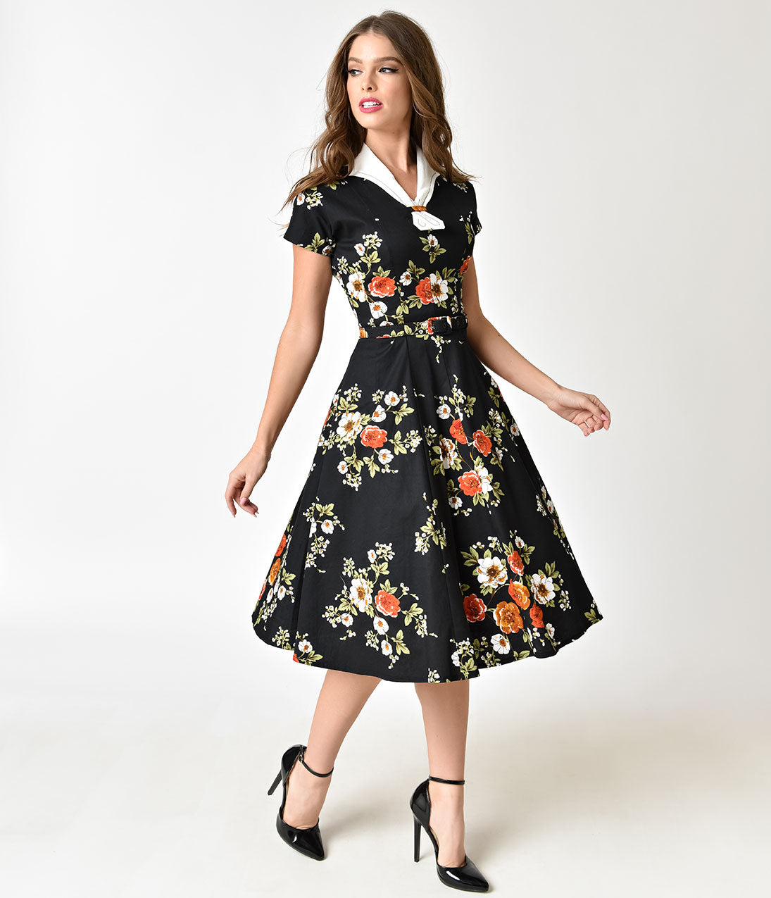What Did Women Wear in the 1940s? 40s Fashion Trends 1940S Black Floral Short Sleeve Campbell Swing Dress $98.00 AT vintagedancer.com