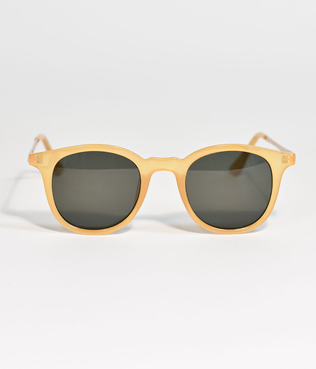 Yellow Inline Retro Sunglasses Flirty frames come in yellow, darling! These A.J. Morgan Yellow Inline sunglasses will pair perfectly with your modern or retro look. Rounded lenses and molded nose pads compliment the sophisticated strength of the metal arms in gold. Be sensational in your bold yellow statement. Staying inline was never appealing until now. ..Available while supplies last. | Yellow Inline Retro Sunglasses