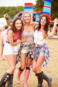 Three bohemian girls in shorts and boots having a fun time at Coachella Music Festival