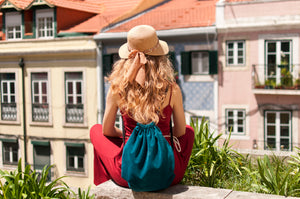 Female traveler in Europe wearing hat and backpack