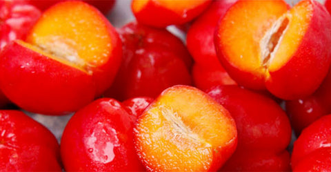 Vibrant red and yellow acerola cherries