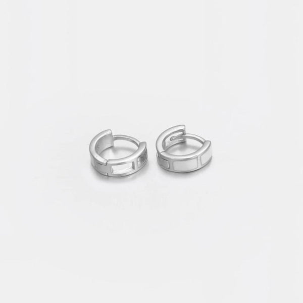 White Band Huggie Earrings In Sterling Silver