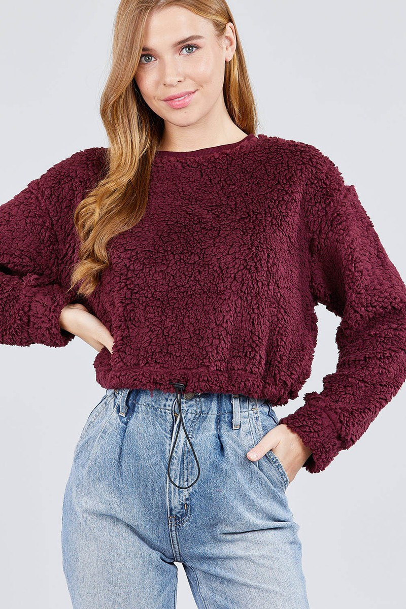 This cozy, comfy, Faux Fur Top will go with anything in your wardrobe! It features long dolman sleeves, a round neckline, solid pattern and a toggle, elastic hemline. Pair with jeans or pants. Color burgundy. Size S, M, L. From our be unique boutique. Description: Pattern: Solid, Neckline: Round, Material: 100% Polyester, Sleeve Length: Full, Hemline: Elastic, Fashion Element: Toggle.