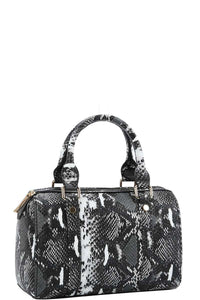 This Python Pattern Bag has plenty of room to carry your everyday essentials and is completely in style! This bags features a top zipper closure, python pattern, smooth textured PU leather, detachable and adjustable long strap, inside zipper wall pocket on the back side, inside double open wall pocket on the front side and soft inside lining. Choose from black, blue, brown, green or red. From our Utterly Unique Boutique.