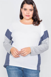 Soft and cozy is in and we have you covered with this cute Soft Knit Top featuring a round neckline, color block sides, full sleeves, dropped shoulders, high-low hemline and is stretchy. Pair with anything in your wardrobe for a great look. Color ivory/gray/navy. Size 1XL, 2 XL, 3XL. From our Utterly Unique Boutique. Description: Material: 68% Polyester, 28% Rayon Fashion Element: Color Block Sleeve length: Full Sleeves Neckline: Round, Hemline: High-Low, Elasticity: Stretchy.