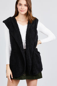 Stay warm this winter in this cozy, Hooded Faux Fur Vest. Featuring an open front, pockets and a hood. Choice of color black. Size XL, 1XL, 2XL. From our unique boutique. Description: Material: 100% Polyester, Sleeve Length: Sleeveless, Fashion Element: Pockets, Hood, Pattern: Solid, Closure: Open Front.