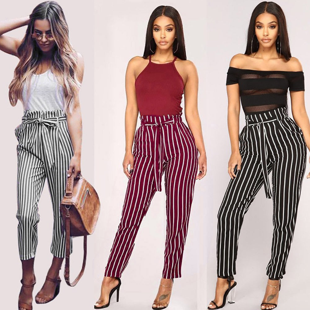 Comfortable and trendy, these popular Striped Drawstring Pants can be paired with heels or flats. Featuring a full length or capri, high elastic waistline, drawstring or belt loops, striped pattern and pockets. Choose from black, wine or white. From our Utterly Unique Boutique. Description: Material: Polyester, Length: Full Or Capri, Waistline: Elastic, High, Fashion Element: Drawstring, Belt Loops Pockets, Pattern: Striped.