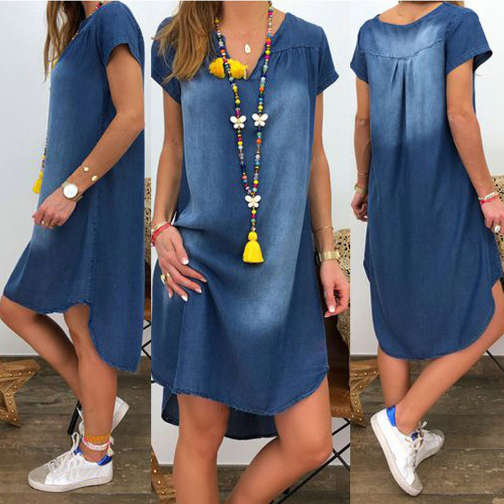 This must-have, awesome Sharkbite Denim Dress is a staple for your closet! Featuring short sleeves, a V-neckline, solid pattern, stonewashed, pleats, loose fit and falls above the knee with a sharkbite hemline. Pair with sandals or flats. Choice of color blue. From our unique boutique.