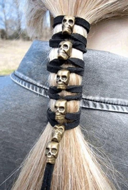 "Tie your hair back with this lightweight Skull Hair Tie or use as a hairband. It features an elastic band decorated with 6 sliding skulls, is lightweight and has a long length. Color silver or gold plated. Delivery 4 days. From our Utterly Unique Boutique. Description: Material: Elastic, Polyester, Pattern: 6 Skulls, Length: 47.2"",  Skull Size: 0.5"" x 0.4""."