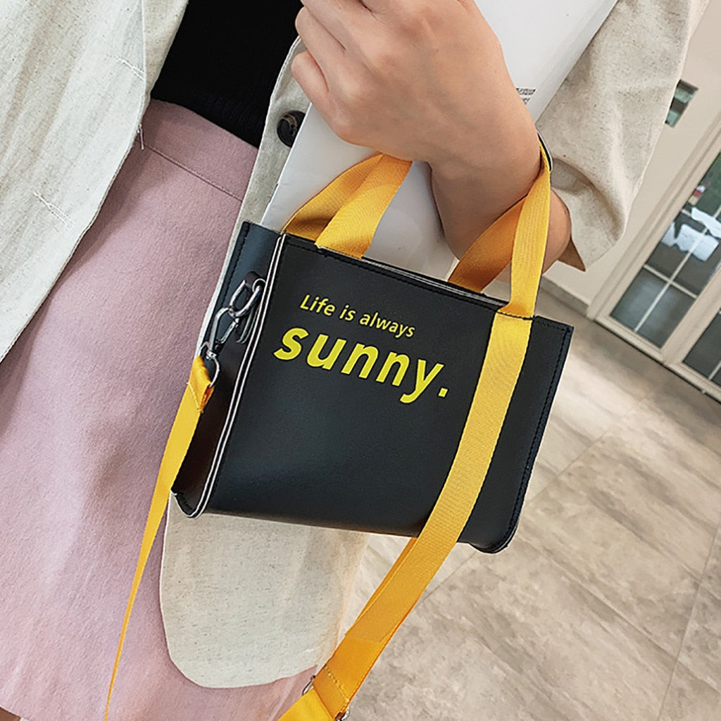 Carry off this Sunny Crossbody Bag for a fun cute look! Featuring a zipper closure with a flap, solid pattern with the words life is always sunny written on it, an adjustable detachable strap, soft to the touch with a smooth texture and top handles. Choose from 2 colors. Delivery 5-7 days. From our Utterly Unique Boutique. Description: Strap: Adjustable, Detachable,