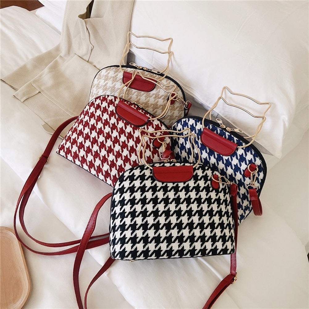 Your sure to receive compliments with this fun and unique Houndstooth Handbag. Featuring a wool houndstooth pattern, zipper closure, soft to the touch, a detachable shoulder strap and a cat shaped double handle. Your choice of 4 colors. Delivery 4-13 days. From our Utterly Unique Boutique. Description: Closure: Zipper, Hardness: Soft, Interior Pockets: No, Number of Handles/Straps: Double Handle & Single Detachable Strap, Pattern: Houndstooth,