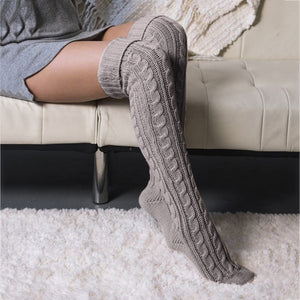 Keep your legs covered with these toasty warm knitted Thigh High Socks. Featuring a solid knitted pattern, over the knee length and soft and stretchy. Color gray. Delivery 4-13 days. From our Utterly Unique Boutique. Description: Length: Over The Knee, Material: Cotton, Size: One Size Fits Most.