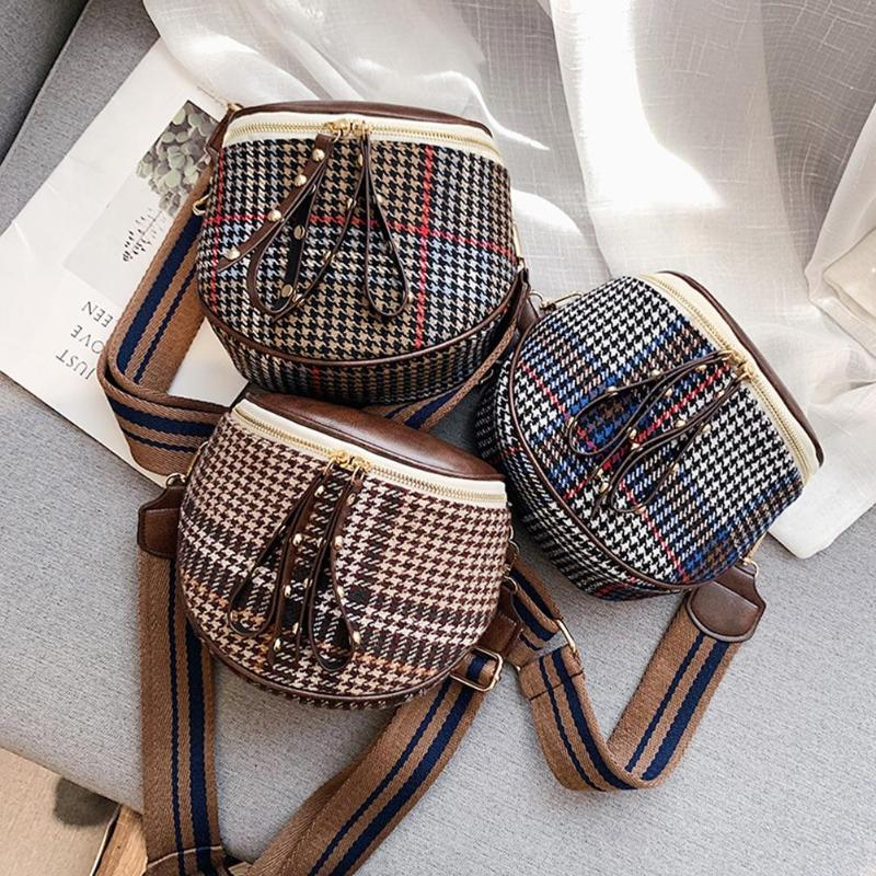 Carry off this Fabric Shoulder Bag for a super cute look! Featuring a wool houndstooth front, double zipper top closure with two studded straps, soft to the touch, interior zipper pocket, and a wide, removable and adjustable shoulder strap. Choose from red, blue or brown. Delivery 4-13 days. From our Utterly Unique Boutique. Description: Shoulder Strap: Wide, Adjustable, Removable,