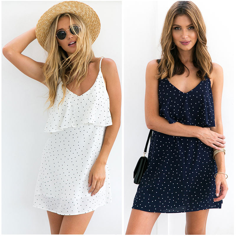 Simple Ruffle Dress - Be Unique Boutique - $15.99 - FREE SHIPPING - This cute yet simple dress has class. It features above the knee length, spaghetti straps, ruffles, a dotted print and v-neckline with a plunging back. Looks great with sandals, flats or wedges. Your choice of white or navy. From our be unique boutique. Description: Sleeve: Spaghetti Straps, Pattern: Dots, Material: Polyester