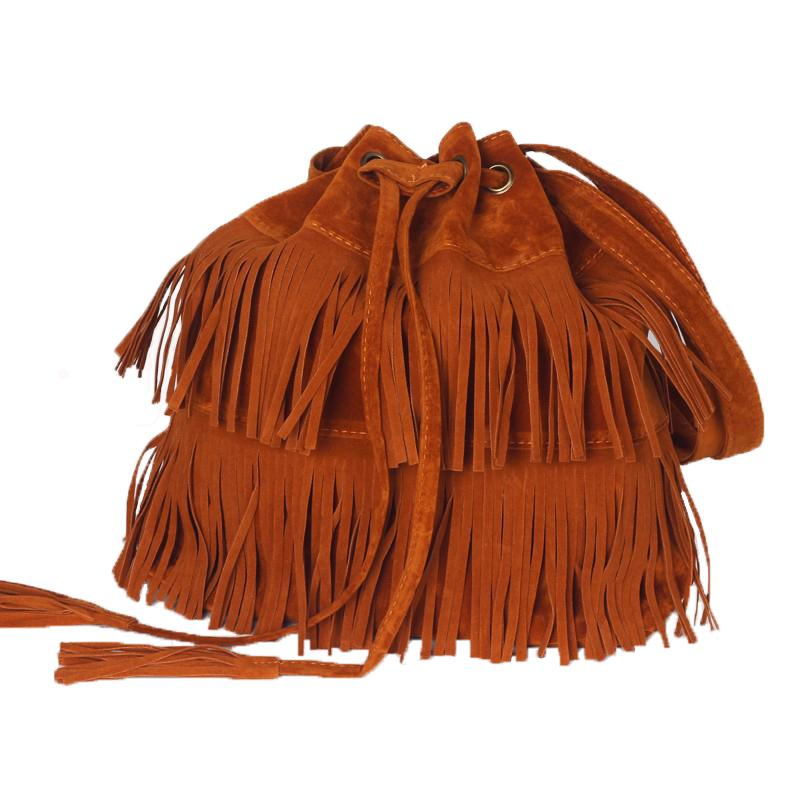 Suede Fringe Purse - Utterly Unique Boutique - FREE SHIPPING - $15.99 - This popular suede handbag features fringe, a drawstring with a snap closure, adjustable strap, an interior compartment, cell phone pocket, and zipper pocket. Your choice of auburn, black or khaki. From our Utterly Unique Boutique. Description: Material: Suede, Fashion Element: Fringe, Interior: Compartment, Cell Phone Pocket