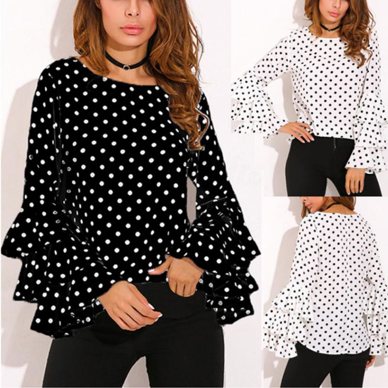 This fashionable Tiered Bell Sleeve Top looks great on. It features full, tiered, bell sleeves, a round neckline and polka dot pattern. Choice of color black or white. Size S-5XL. From our Utterly Unique Boutique. Description: Fabric: Chiffon, Fashion Element: Tiered, Bell Sleeves, Sleeve Length: Full, Pattern: Polka Dot, Collar: Round.