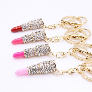 "Show some bling with this Rhinestone Lipstick Keychain! This super cute accessory is stylish and fun. Easy to clip on your handbag or where ever you choose. Available in 4 colors. Delivery 1-5 days. From our be unique boutique. Description:Item: Rhinestone Lipstick Keychain, Use: Clip On Your Handbag Or Where Ever You Choose, Fashion Element: Two-Ring Design Allows You To Wear It, Rhinestones, Metal: Alloy, Size: 2"" Long x 0.5"" Wide, Total Length: 4.6""."