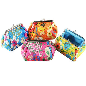 "This Floral Coin Purse is bright enough to find in your handbag and can also hold cards, keys or what ever you choose. It features a pretty floral pattern, inside lining, lightweight and a clasp closure. Choose from tangerine, yellow, blue or pink. Delivery 4-7 days. From our unique boutique. Description: Material: Polyester, Size: 5.1"" x 3.7"" x 3.6"", Weight: Lightweight, Closure: Clasp, Pattern: Floral."