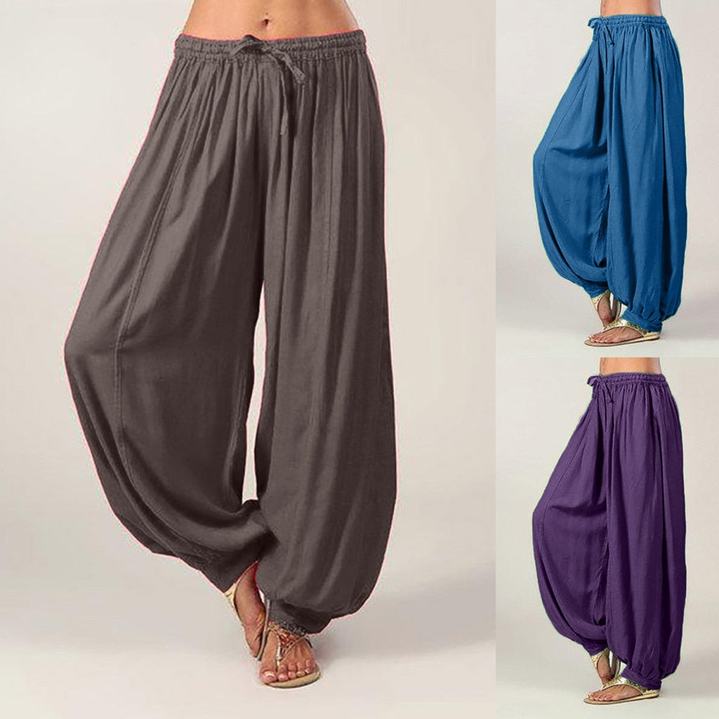 These comfy Pleated Harem Pants will soon become your favorite. Featuring a loose fit, wide leg, solid pattern, full length and an elastic waist with a drawstring and pleated front. Your choice of blue, purple or gray. Delivery 4-13 days. From our Utterly Unique Boutique. Description: Pattern: Solid, Material: Cotton Blend, Length: Full, Style: Wide Leg, Fashion Element: Pleats, Closure: Elastic Waist, Drawstring, Fit: Loose.