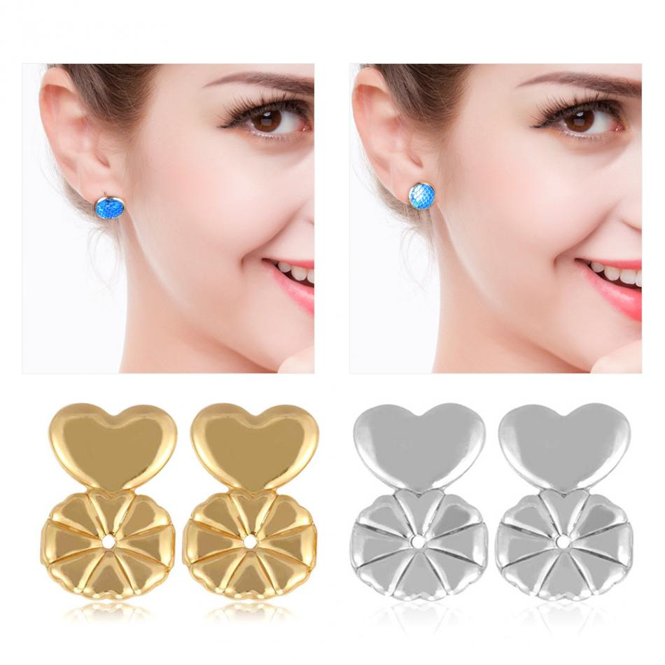 Earring Lifters - Unique Boutique - $4.99 - FREE SHIP - No Sagging - No more sagging earrings! These great earring lifters give support and easily slide onto the post of your earrings to keep them from sagging. Perfect for bad piercings, stretched lobes or heavy earrings. Your choice of a gold finish, silver finish or both. From our unique boutique. Description: Shape: Heart, Material: Copper.