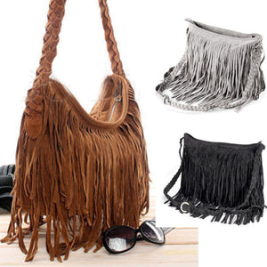 "This popular Suede Fringe Purse features a zipper closure, fringe, braided adjustable strap, an interior compartment, an interior cell phone pocket and is soft to the touch. Your choice of black, gray or auburn. Delivery 4-13 days. From our Utterly Unique Boutique. Description: Material: Suede Fashion Element: Fringe, Braid Interior: Compartment, Cell Phone Pocket, Closure: Zipper, Hardness: Soft, Number of Straps: Single, Adjustable Braided Strap, Size: 14.9"" x 10.6"" x 4.3"", Strap Drop: 59""."