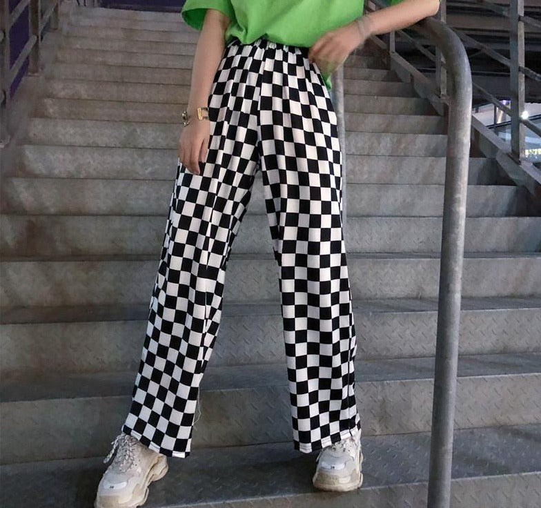 These loose, awesome pair of Checkered Pants are cute and flowy. They feature a checkered pattern, high elastic waistline, full length, loose fit and a wide leg fit. From our Utterly Unique Boutique. Description: Material: Polyester, Fashion Element: Wide Leg, Length: Full, Waistline: High, Elastic, Fit: Loose, Pattern: Checkered, Thickness: Thin.