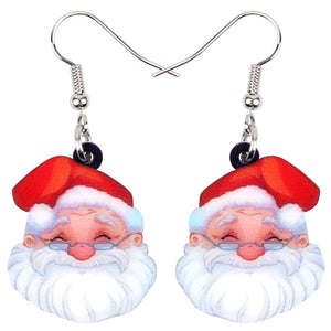 "These sweet Santa Earrings are sure to be a hit this holiday season! These cute drop earrings feature a hook with a Santa face. Give as a perfect gift. Delivery 4-10 days. Color multi-colored. From our Utterly Unique Boutique. Description: Earring Type: Drop, Closure: Hook, Material: Acrylic, Shape: Santa Face, Size: 1.06"" high x 0.9"" wide."