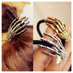 "Dress up your hair up with your choice of a Skeleton Hand Hair Clip Or Tie for a fun look. Featuring an elastic tie or clip. Choose from gold plated or silver. Delivery 4-13 days. From our unique boutique. Description: Item: Hair Clip Or Hair Tie Shape: Skeleton Hand, Material: Alloy, Hair Tie Diameter: 1.8"", Hair Clip: 2"", Quantity: 1 Piece."