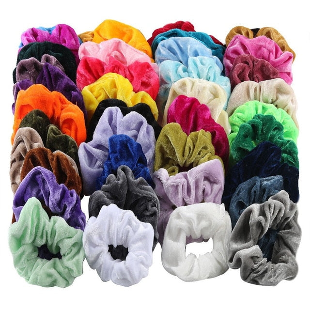 Toss your hair up with one of the 52 Piece Velvet Scrunchies for a stylish and cute look, sure to go with everything in your wardrobe! They feature a solid pattern, elasticity and soft velvet material. Includes 52 different colors. From our Utterly Unique Boutique. Estimated delivery 4-13 days. Description: Pattern: Solid Material: Velvet, Size: One Size Fits Most.