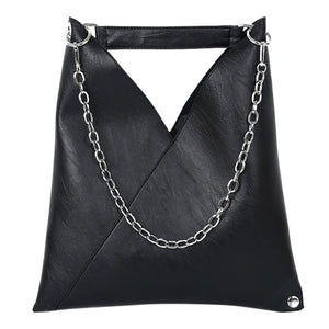 "Carry off this Chic Handbag for a super cute look! This handbag can be worn many different ways. Featuring a soft texture, snap closure, chain strap, top handle, interior slot pocket and solid pattern. Color black. 4-12 day delivery. From our Utterly Unique Boutique. Description: Strap: Chain, Top Handle, Interior: Slot Pocket, Closure: Snap, Lining: Polyester, Material: PU Pattern: Solid, Hardness: Soft, Size: 14.6"" (H) x 11.8"" (L) x 0.8"" (W)."