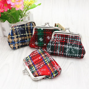 "Carry around this fun plaid, Snowflake Coin Purse all season or give as a gift. Choose from 3 patterns. From our fabulous handbags and accessories. Description:Material: Linen, Pattern: Snowflakes, Plaid, Closure: Clasp, Size: 4"" x 3""."