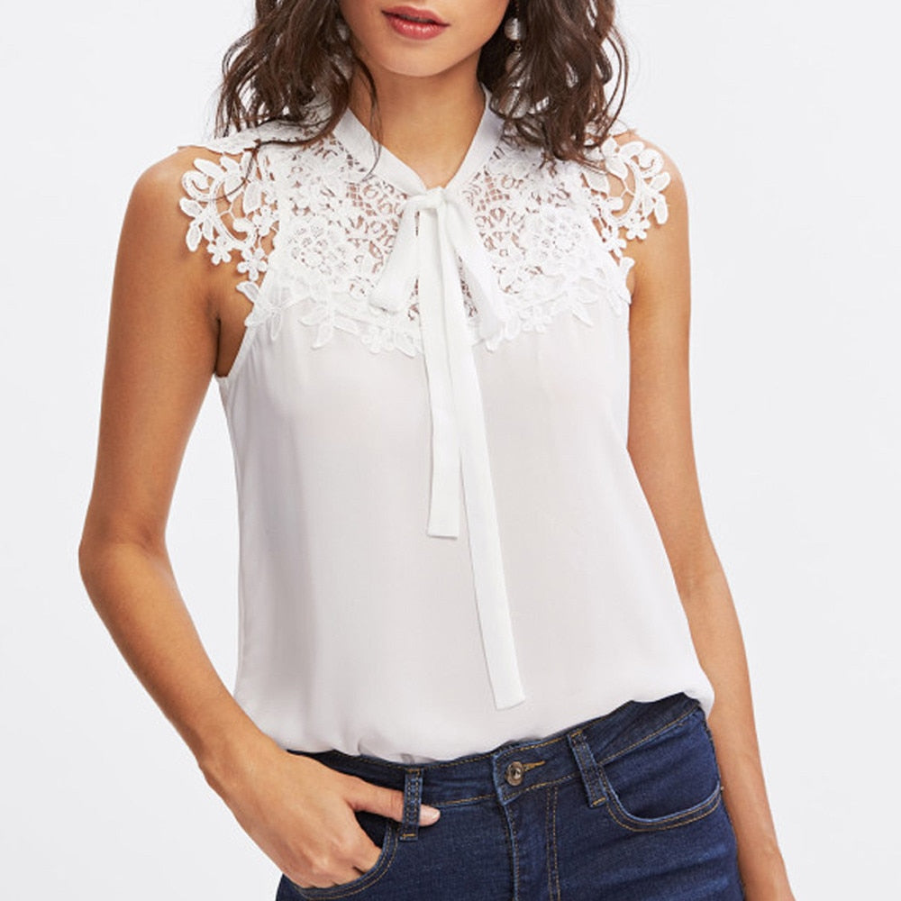Show a little bit of your feminine side with this front and center Lace Bow Top. Featuring a solid pattern, sleeveless, floral lace top and a big bow around the neckline. Color white. From our Utterly Unique Boutique. Description: Pattern: Solid, Material: Chiffon, Collar: V-Neck, Fashion Element: Bow, Floral Lace, Sleeve Length: Sleeveless.