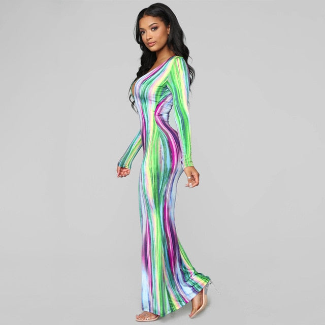 This flowy Multi-Colored Striped Maxi Dress is so cute you won't want to take it off. It features full sleeves, a V-neck, sheath silhouette, solid pattern and falls to the ankle. Choose from 3 pretty multi-colors. Delivery 4-13 days. From our unique boutique. Description: Material: Spandex, Polyester, Silhouette: Sheath, Pattern: Striped, Sleeve Length: Full, Dress Length: Ankle, Neckline: V-Neck.