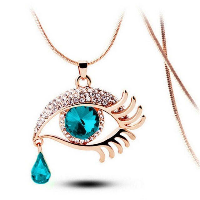 "This Rhinestone Eye Necklace is the perfect statement piece to dress up that outfit. It features a long rope chain with a sparkly eye and tear drop. Choose from aqua, green or yellow. Delivery 4-13 days. From our Utterly Unique Boutique. Description: Chain: Rope, Pattern: Eye And Tear, Material: Alloy, Rhinestones, Crystal, Pendant Size: 4.5"", Length: 23.5""."