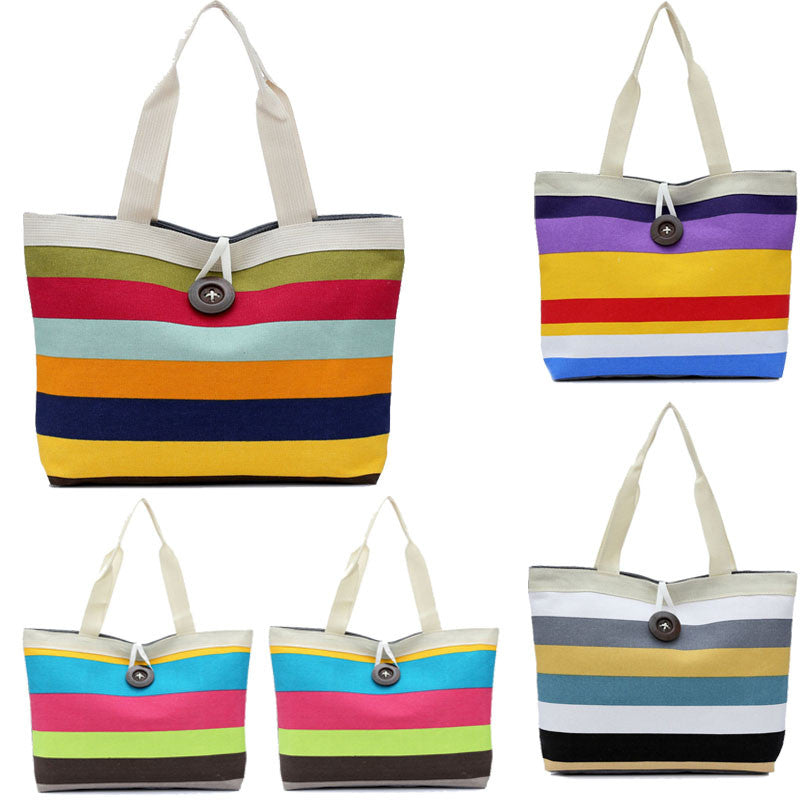 Striped Canvas Shoulder Bag - Be Unique Boutique - $9.99 - SHIPS FREE - Bring in the season with this striped canvas shoulder bag, large enough to hold all your essentials. Featuring an interior compartment, two straps, soft to the touch, striped pattern and a zipper and button closure. Choose from 4 striped patterns. From our Be Unique Boutique. Description: Interior: Compartment, Lining